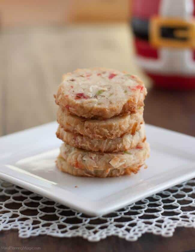 Santa's Whiskers Cookies are a shortbread cookie with candied fruit, nuts and coconut to make a fun and festive way to celebrate the holidays! Easy to make ahead too.