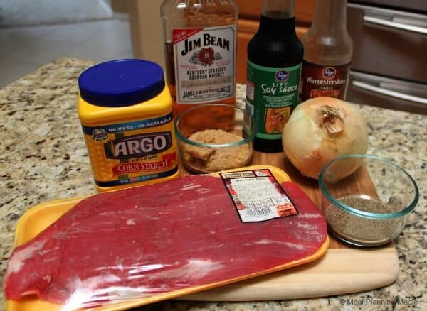 Easy Marinated Bourbon Flank Steak Recipe - via MealPlanningMagic.com