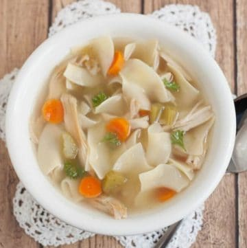 You won't believe how easy and delicious this Homemade Chicken Noodle Soup is! Make it on the stovetop or in a slowcooker or pressure cooker! #chickennoodlesoup #homemadesoup #pressurecooker #slowcooker #rotisseriechicken #easysouprecipe