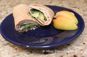 A Jerk chicken wrap with spinach and avocado is the perfect lunch box sandwich or light dinner!