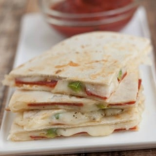 A tasty twist on a traditional quesadillas recipe that combines the favorite flavors of pizza, this recipe is quick and easy for a snack or light dinner! | Get the recipe at MealPlanningMagic.com