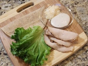 Ingredients to make a chicken Caesar salad wrap