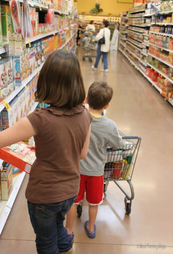 Kid-sized shopping carts at one of our local stores makes it fun to have kids help you shop