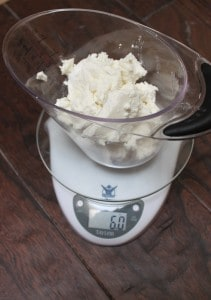 measuring goat cheese with a kitchen scale