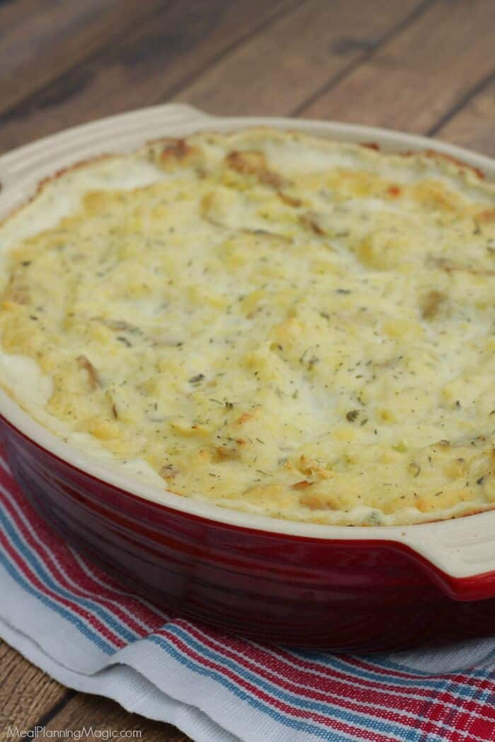 Make ahead and freezer friendly? You won't believe how easy this Garlic Herb Mashed Potatoes Casserole is to make and have on hand for any occasion! | Get the recipe at MealPlanningMagic.com