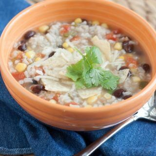 My Chicken Rice and Black Bean Tortilla Soup is a family favorite that is full of flavor and easy enough you can have it on the table in about 30 minutes! | Recipe at MealPlanningMagic.com
