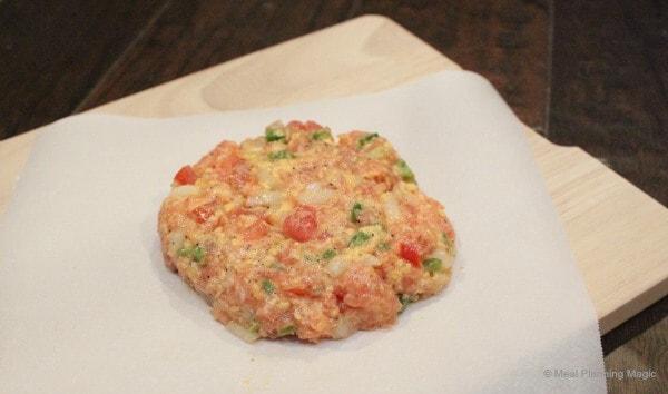 Uncooked jalapeno fresh salmon burgers