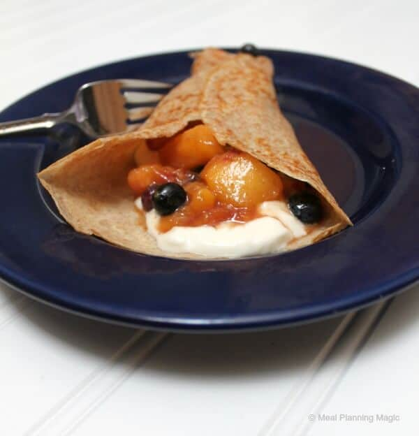 Nectarine-Blueberry Fruit Sauce is delicious folded into crepes with whipped cream | MealPlanningMagic.com
