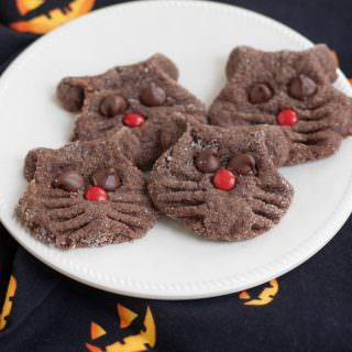 These Super Simple Chocolate Black Cat Face Cookies are fun for kids to make and perfect for your Halloween celebrations. Get the recipe at MealPlanningMagic. com