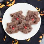This easy Halloween cookies recipe for Chocolate Black Cat Cookies is fun for kids to help with and a fun way to celebrate Halloween. Recipe at MealPlanningMagic. com