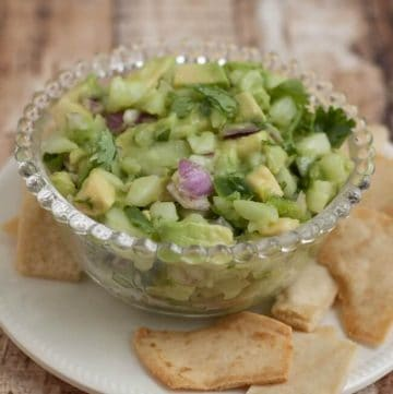 Easy and Delicious Fresh Cucumber Avocado Salsa is healthy, delicious and packed with wholesome vegetables and a little kick of spice. Perfect to use as a garnish on tacos or as a dip for your favorite chips. Get the recipe at MealPlanningMagic. comegetables and a little kick of spice. Perfect to use as a garnish on tacos or as a dip for your favorite chips. Get the recipe at MealPlanningMagic.com