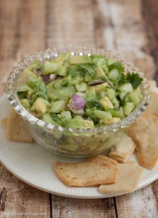 Fresh Cucumber Avocado Salsa </strong>is healthy, delicious and packed with wholesome vegetables and a little kick of spice.  Perfect to use as a garnish on tacos or as a dip for your favorite chips. Get the recipe at MealPlanningMagic.com