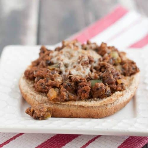 These open-faced pizza sloppy joes come together quickly and easily even on the busiest of nights! Make a double batch to keep some in the freezer for any time! Recipe at MealPlanningMagic.com