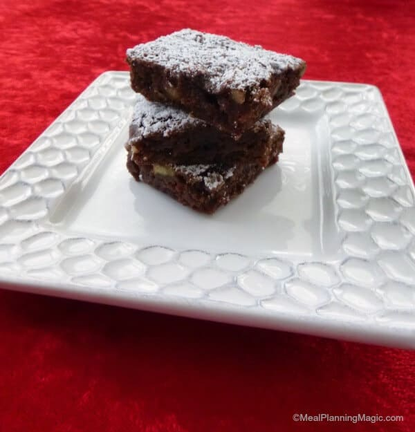 Black Forest Brownies are fudgy brownies with sweet chocolate, crunchy nuts, and cherries.