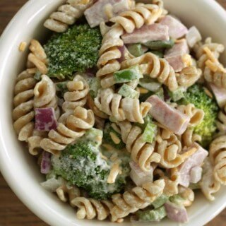 This make ahead Ham & Broccoli Pasta Salad is perfect for a luncheon or dinner when you don't want to turn on the oven! | Recipe at MealPlanningMagic.com