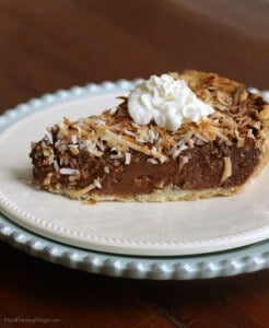side view of slice of German Chocolate Sweet Cream Pie on a white plate and a blue plate
