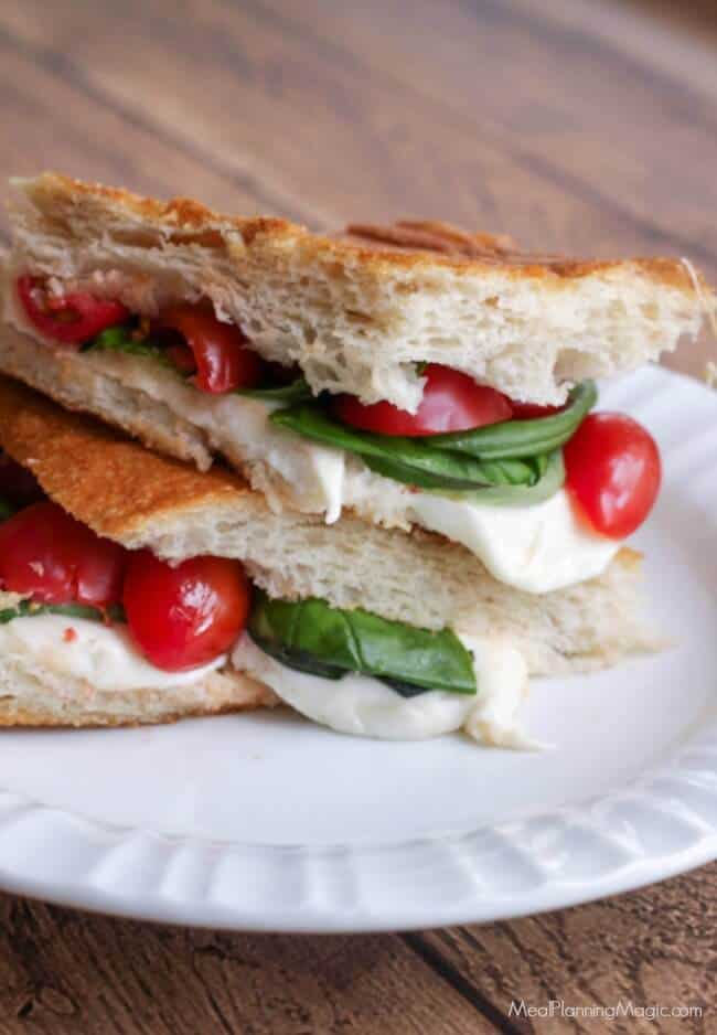This Simple Caprese Panini (with Tomato, Basil and Mozzarella) bursts with garden fresh flavor and it's SO super easy to put together! It may just become your new favorite! | Recipe at MealPlanningMagic.com