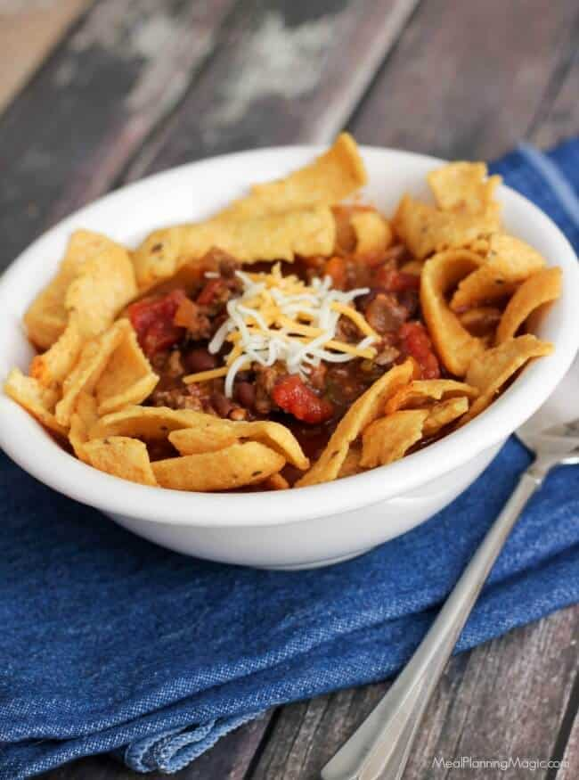 You can enjoy chili year round with Slowcooker Cowboy Chili Frito Pie! Full of better-for-you ingredients, indulge your cravings with this flavorful version! | Recipe at MealPlanningMagic.com