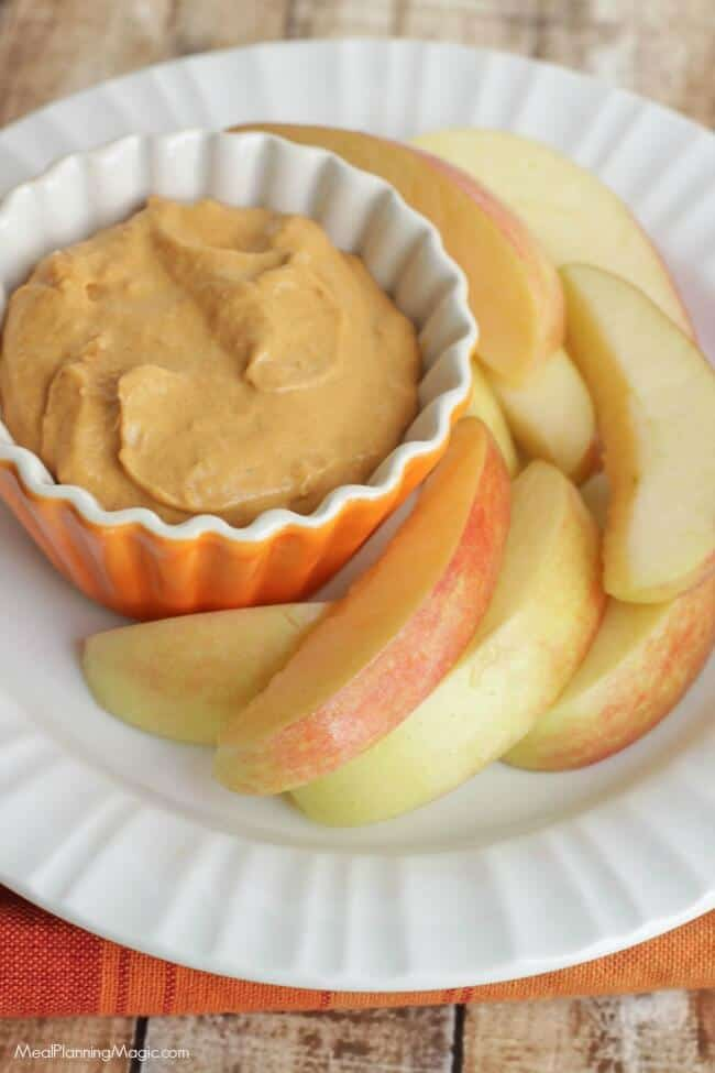 Simple and so tasty with fresh fruit like sliced apples, this Creamy Pumpkin Dip is a perfect fall snack or treat anytime!   Get the recipe at MealPlanningMagic.com