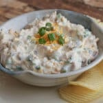 Loaded Baked Potato Dip-only four ingredients and oh, so delicious! It's one of our all-time favorite dips and perfect for any occasion! Get the recipe at MealPlanningMagic.com