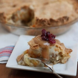 Thanksgiving Leftover Pie is comfort food at it's best! Combine your favorite traditional Thanksgiving leftovers like turkey with a creamy vegetable mixture, stuffing and mashed potatoes then add a pie crust to make this savory pie that is sure to be a huge hit and take reinventing leftovers to a new level. Get the recipe at MealPlanningMagic.com
