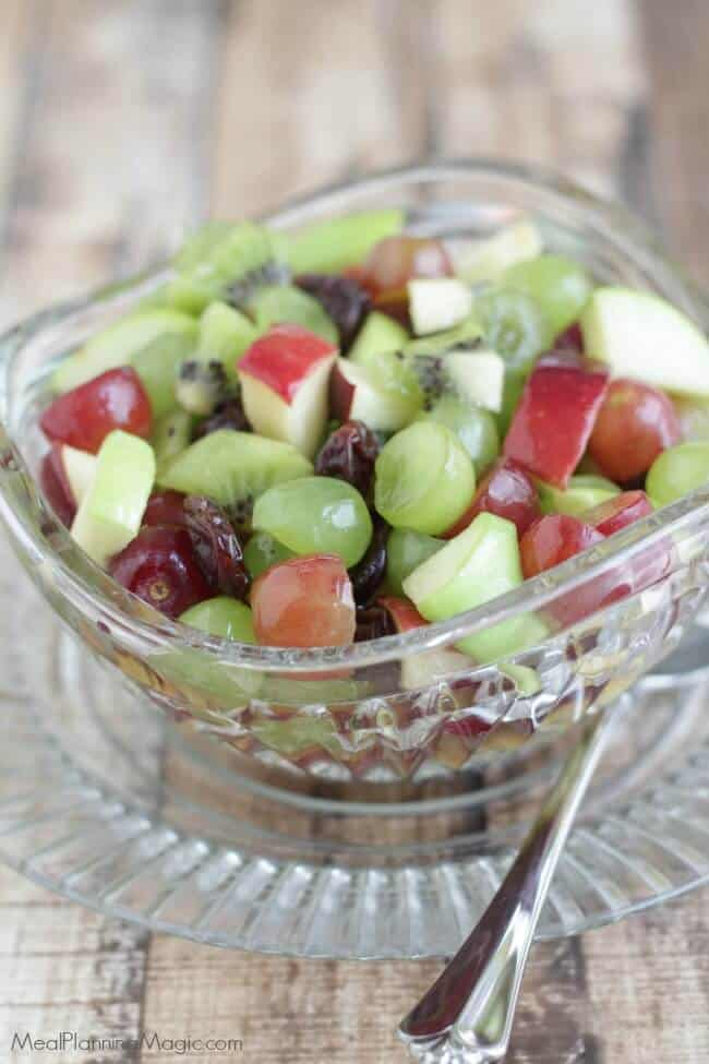 image of Christmas fruit salad with grapes, apples and dried cherries
