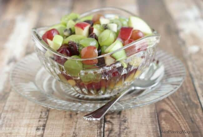 image of Christmas fruit salad with grapes, dried cherries and apples