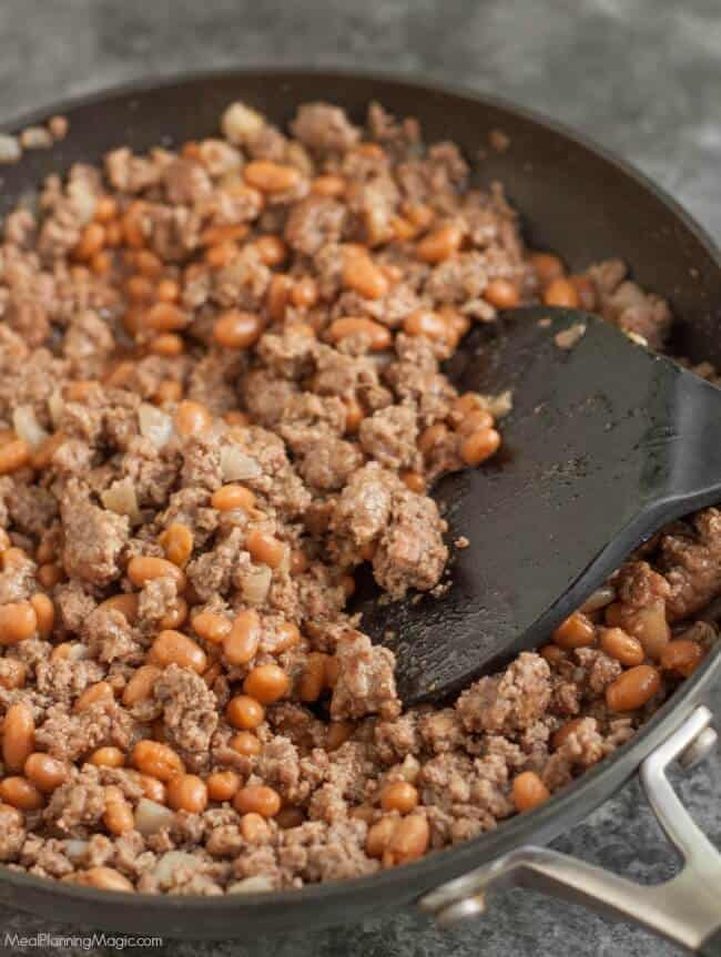 With just a few ingredients, these Easy Beef and Bean Burritos are not only simple to whip up, they are also budget friendly. They are a family favorite! Recipe at MealPlanningMagic.com