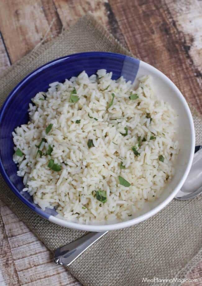 With only a few ingredients, this Cilantro Lime Rice is SO easy and delicious for all kinds of recipes. Plus, you can make it ahead and freeze it too! Recipe at MealPlanningMagic.com