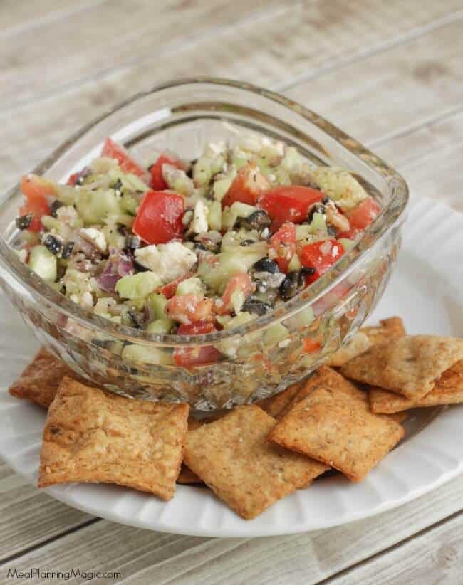 This veggie filled Mediterranean Salsa Dip is so fresh, delicious and super simple! Serve it with pita chips or as a side to grilled chicken or seafood. Find the recipe at MealPlanningMagic.com