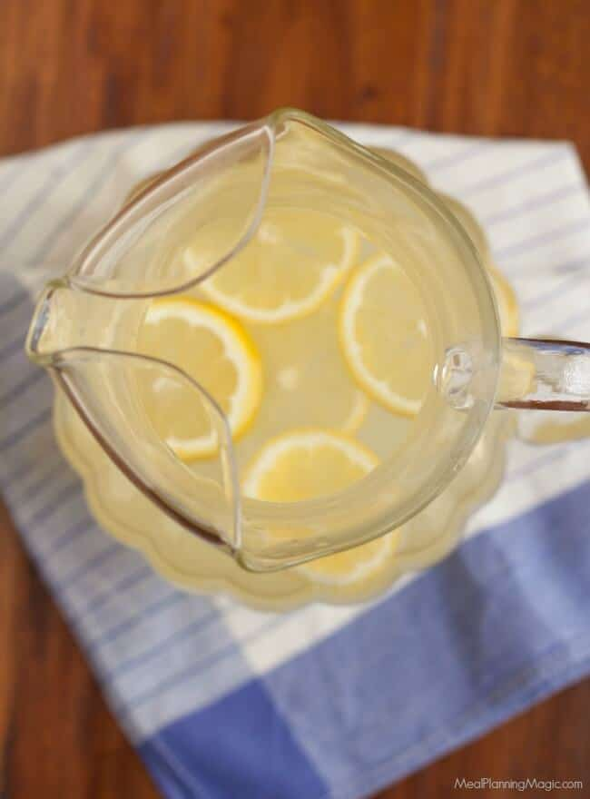 Making your own Homemade Lemonade Concentrate for the Freezer is super easy and lets you enjoy fresh lemonade year round! Get the recipe at MealPlanningMagic.com