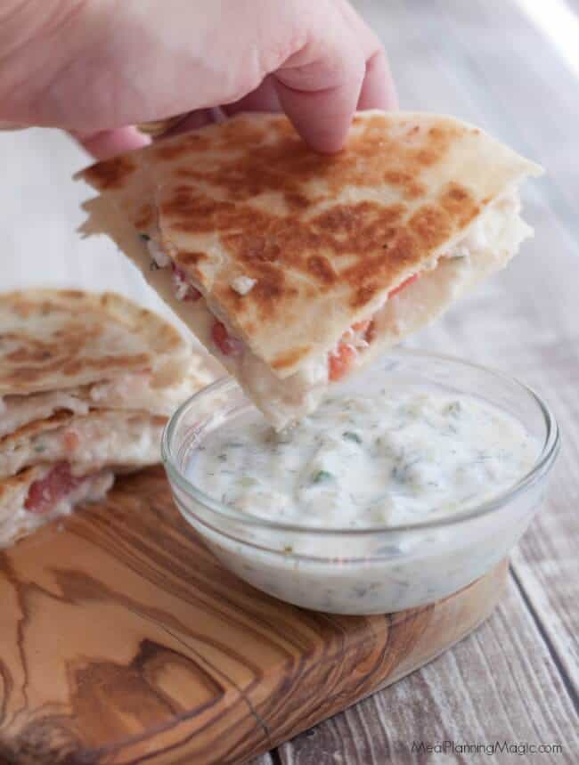 """Simple Mediterranean Quesadillas</strong> are a delicious twist on traditional quesadillas and a great go-to option for an easy lunch or dinner. </em></p> <p style=""""text-align: center;""""><em>You can even prep ahead the filling to make them even easier come meal time! Get the recipe at MealPlanningMagic. com"""