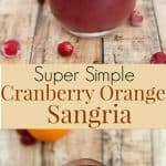 Cranberry Orange Sangria in a glass with cranberries and orange slice floating at top and whole orange at upper left of glass.