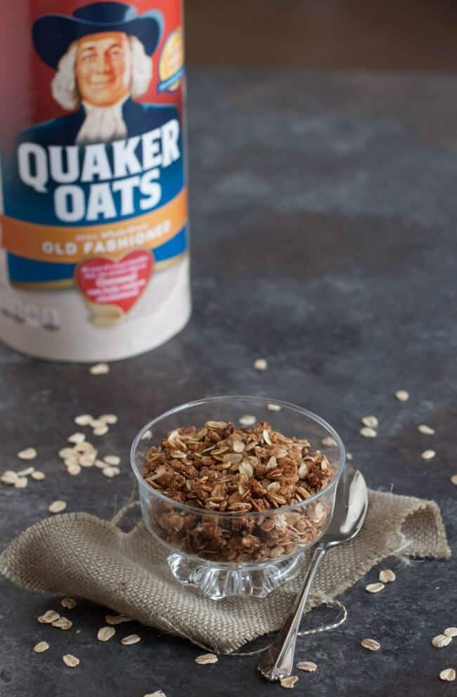 image of homemade slowcooker granola in bowl and Quaker Oats container