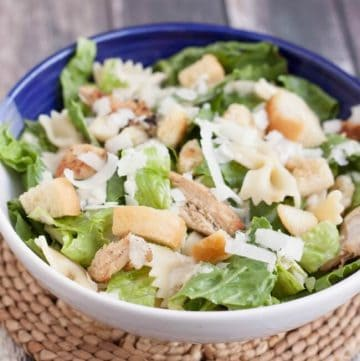 Delicious Chicken Caesar Pasta Salad is a huge hit in my house! Everything is made from scratch and I love that most of it can be made ahead too.