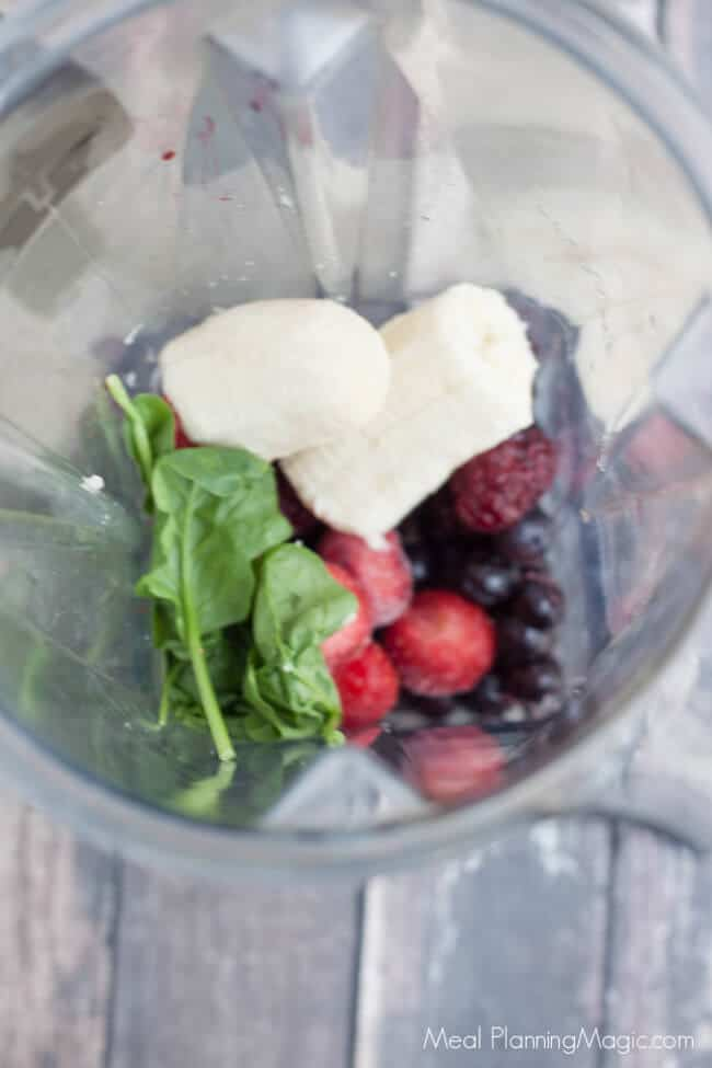 image of triple berry banana and spinach in blender