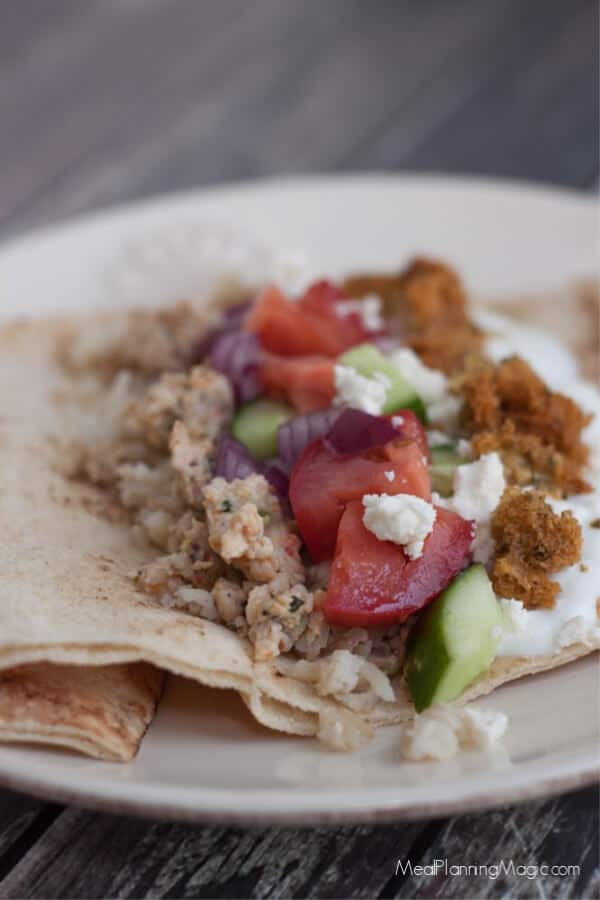 These Simple Greek Tacos are bursting with fresh vegetables, falafel and Greek seasoned ground beef, are a family favorite and really are so simple!