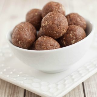 Image of Peanut Butter Chocolate Energy Bites in bowl on plate.