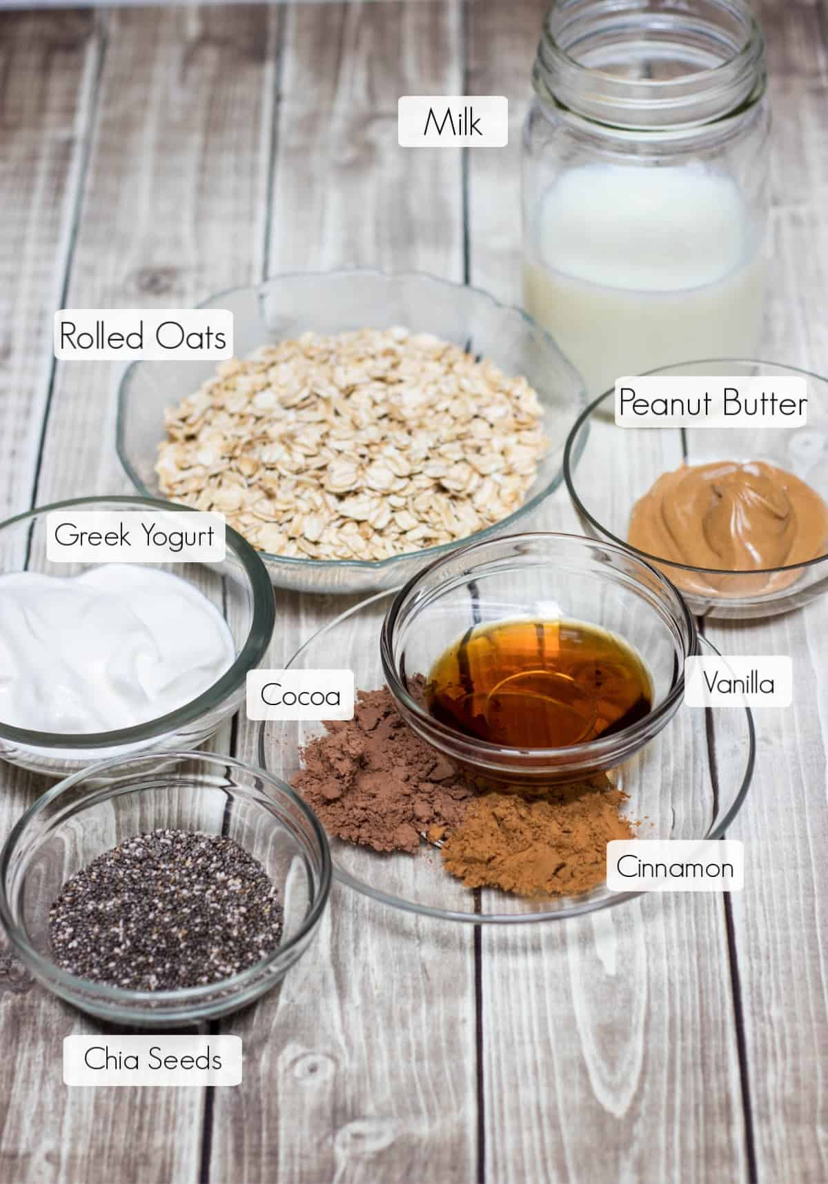 Image of labeled ingredients in bowls for Cinnamon Chocolate Peanut Butter Overnight Oats.