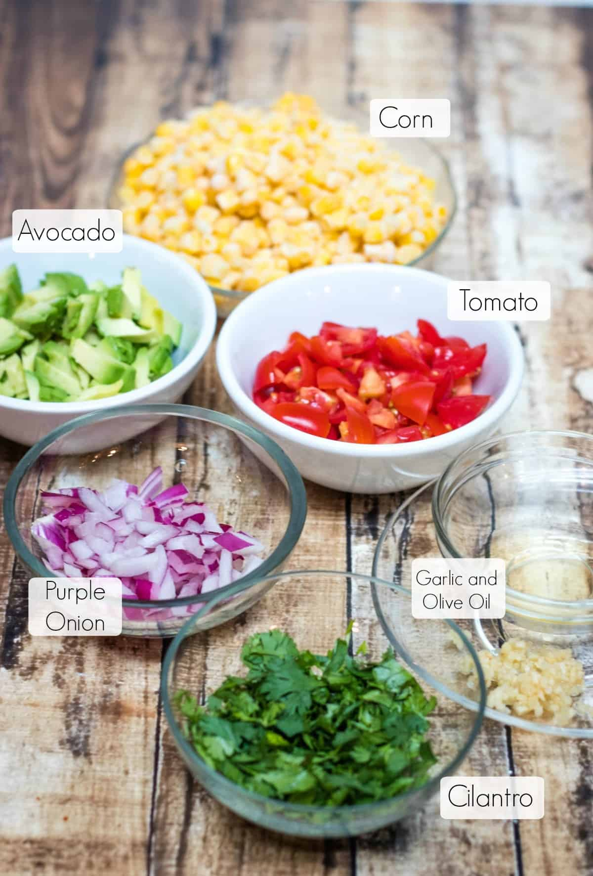 Image of ingredients for corn, avocado and tomato salsa.