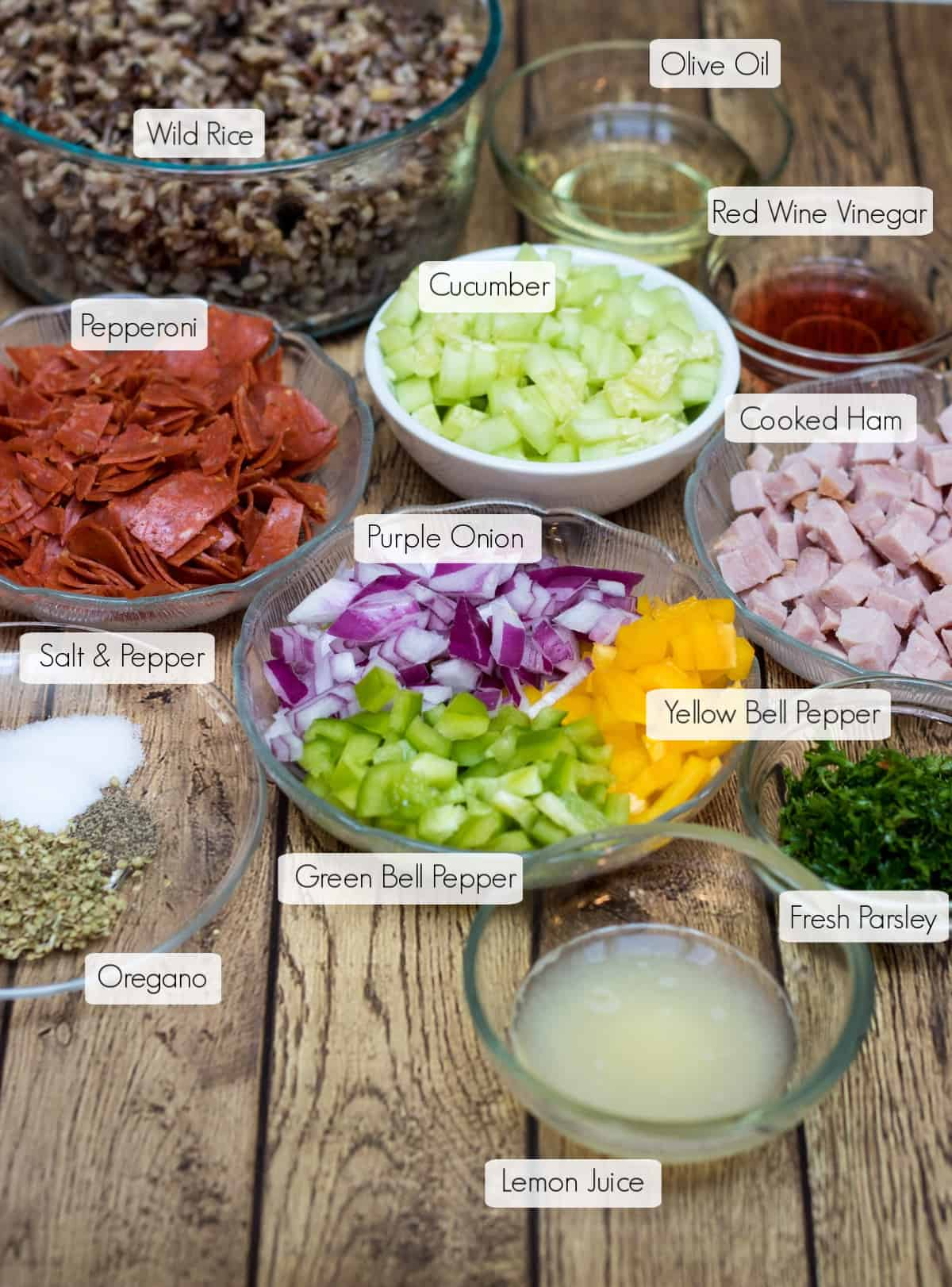 Labeled ingredients in bowls for Italian Vegetable Wild Rice Salad