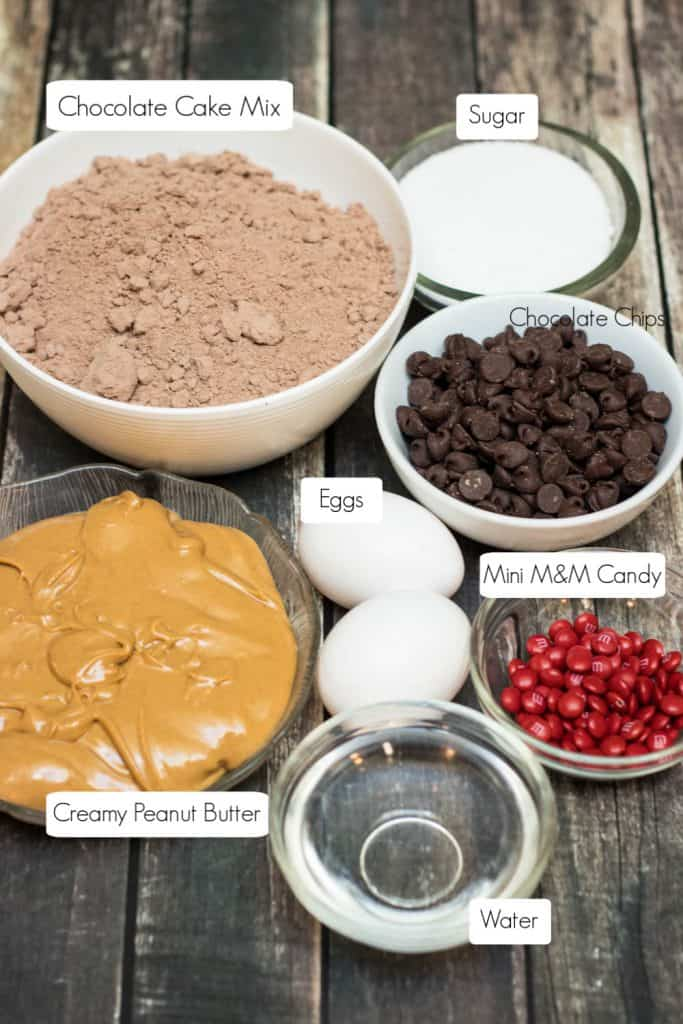 Ingredients in bowls for chocolate black cat cookies.