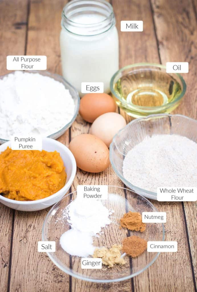 Image of ingredients in bowls to make pumpkin spice waffles with labels next to each.