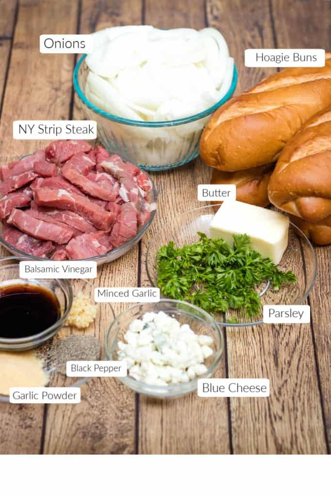 Steak and onion sandwich ingredients in bowls with labels for each.