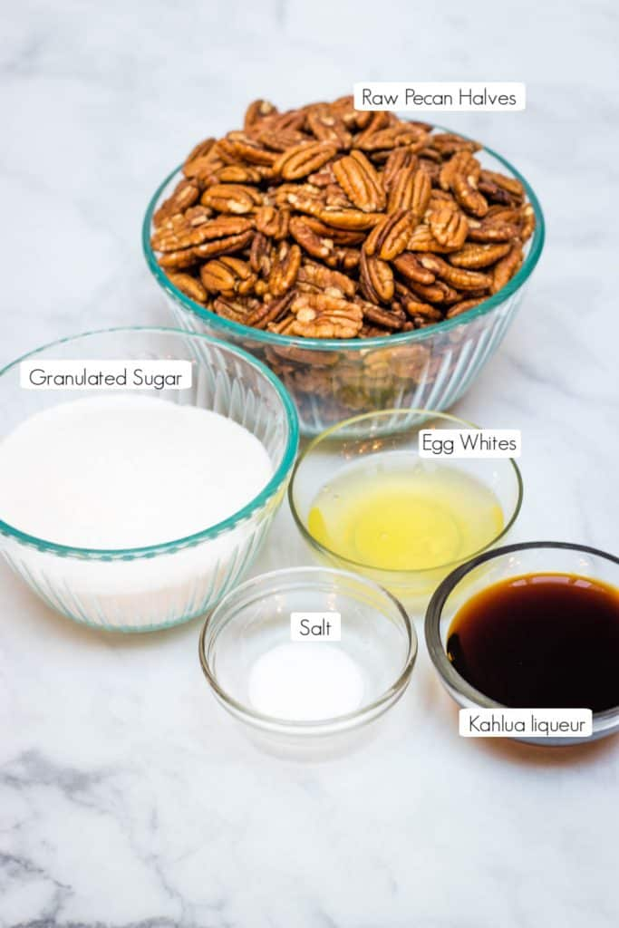 ingredients in bowls for Kahlua sugared pecans with labels for each