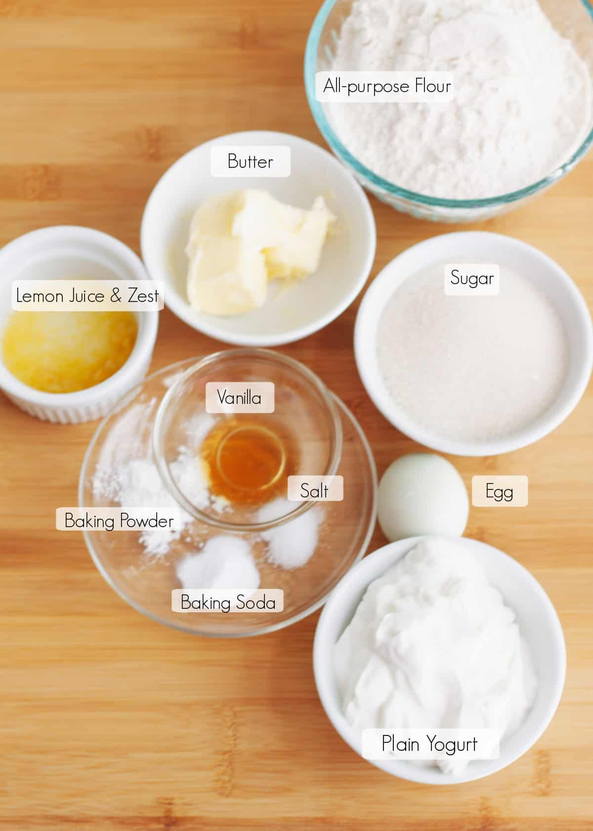 Labeled ingredients in bowls to make lemon bread recipe.