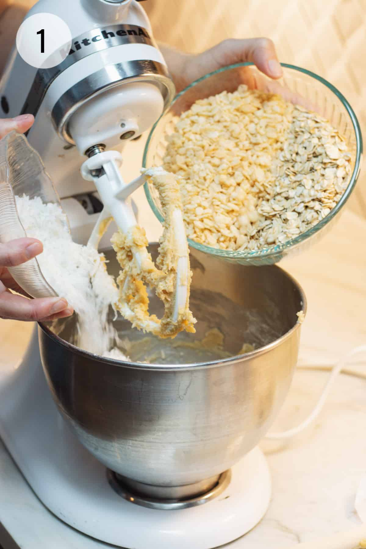 Pour dry ingredients for Cracker Jack Rice Krispie Cookies into mixer bowl of a stand mixer.