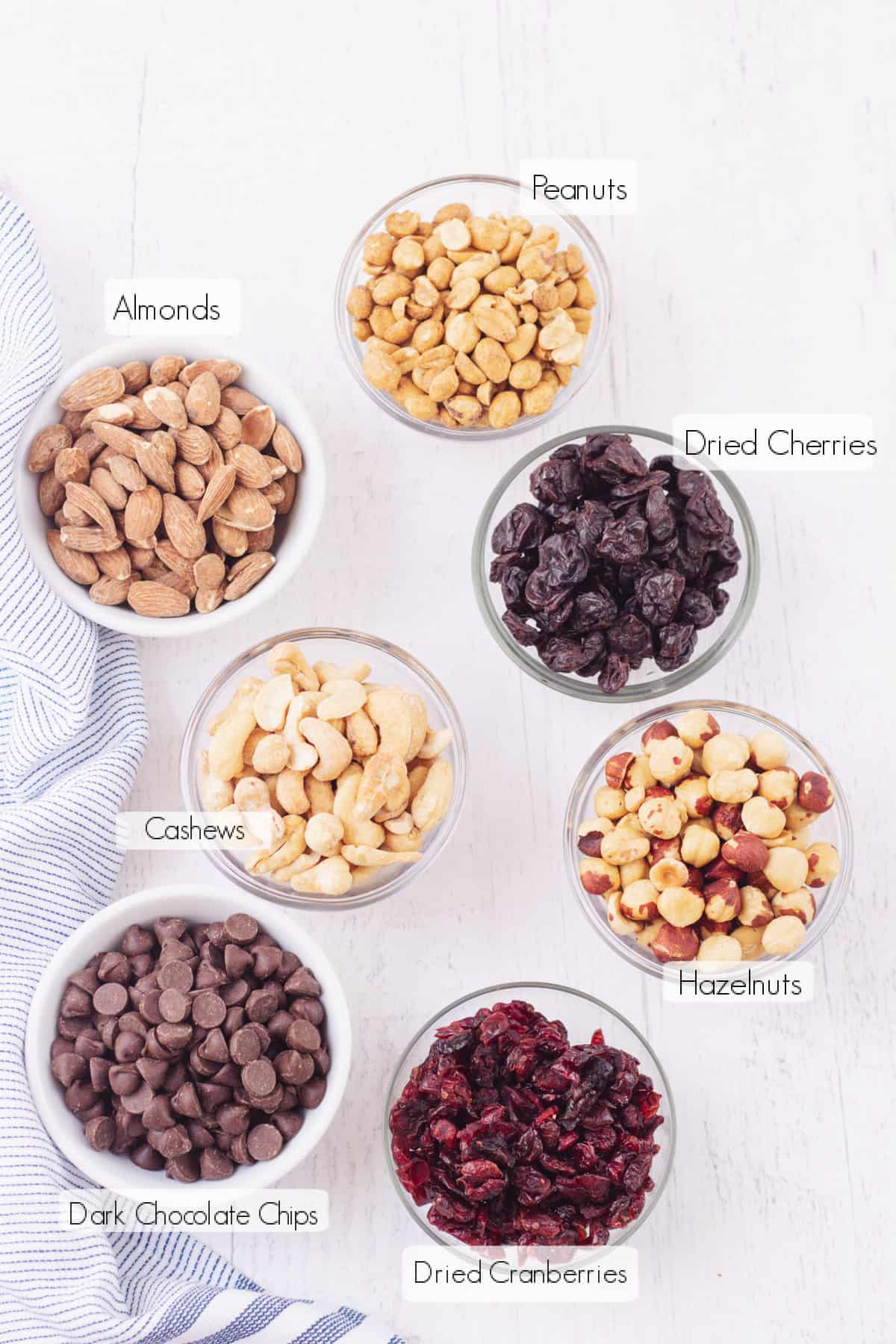 Labeled ingredients in small bowls to make Dark Chocolate Cherry Homemade Trail Mix.