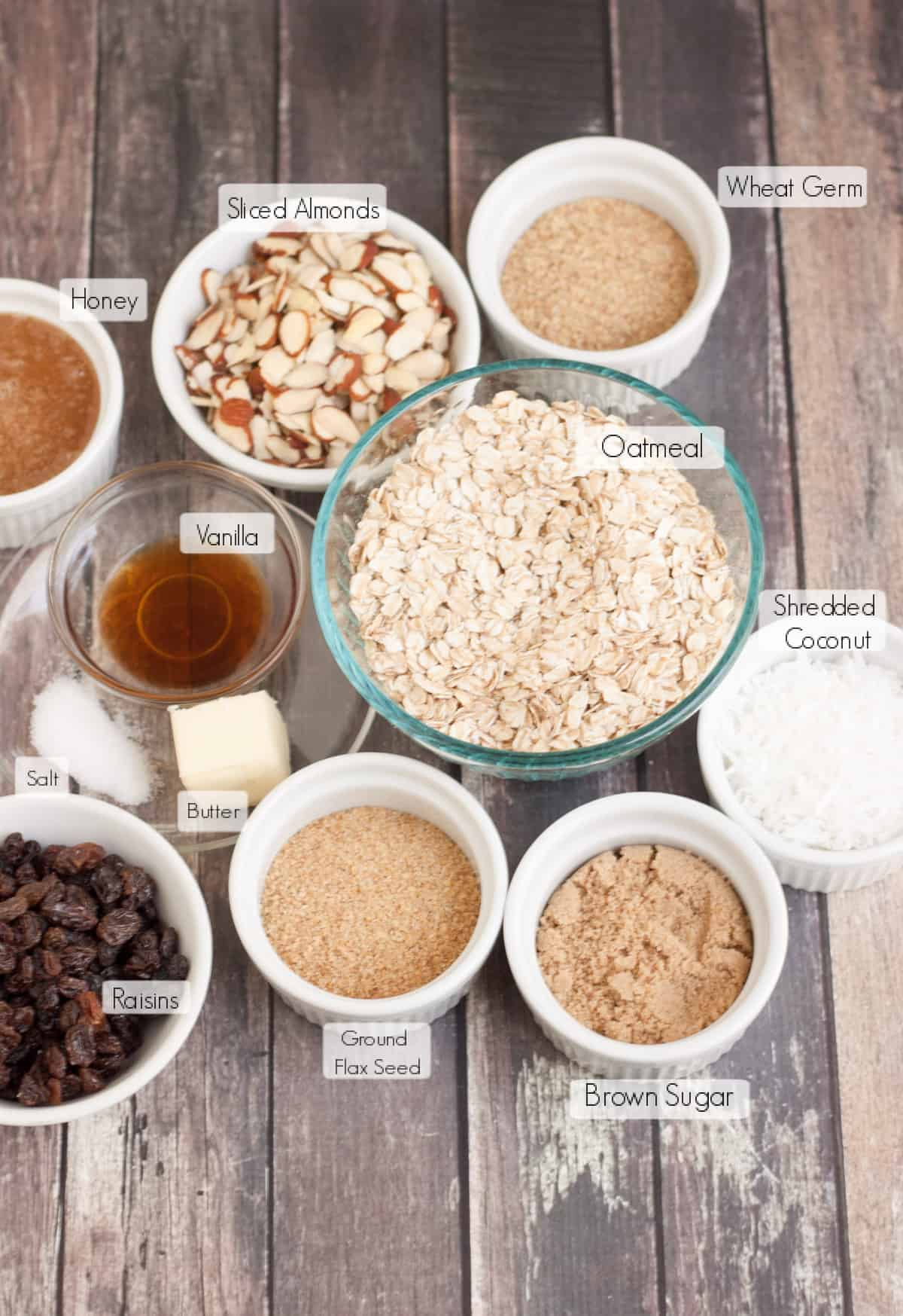 Labeled ingredients in bowls to make homemade granola bars.