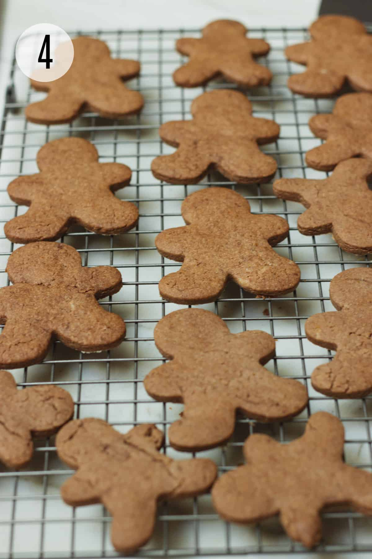 Baking rack with gingerbread man shaped Mexican chocolate sugar cookies.
